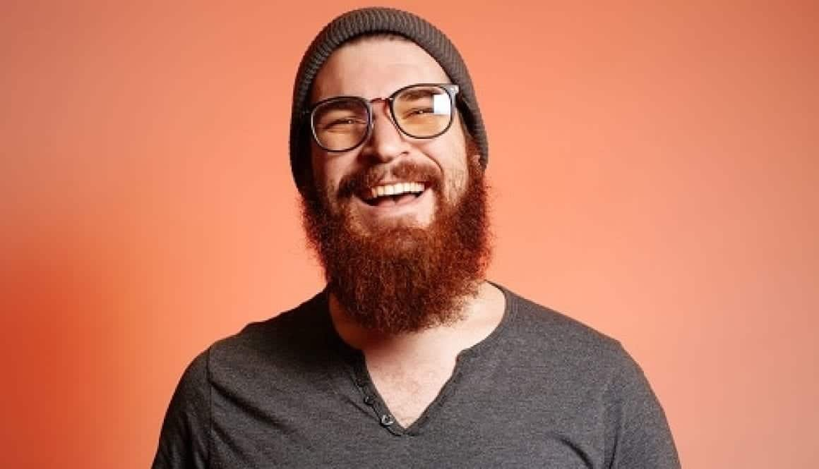 brochure 8 man with red beard and glasses resized