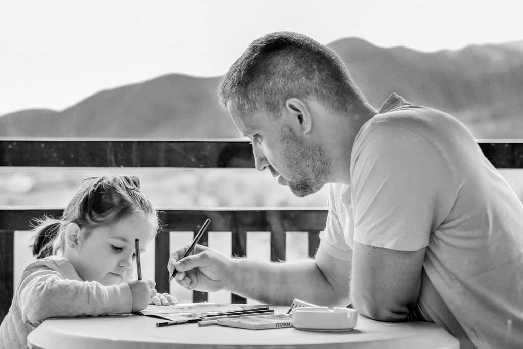 Father and daughter working together on his memoir