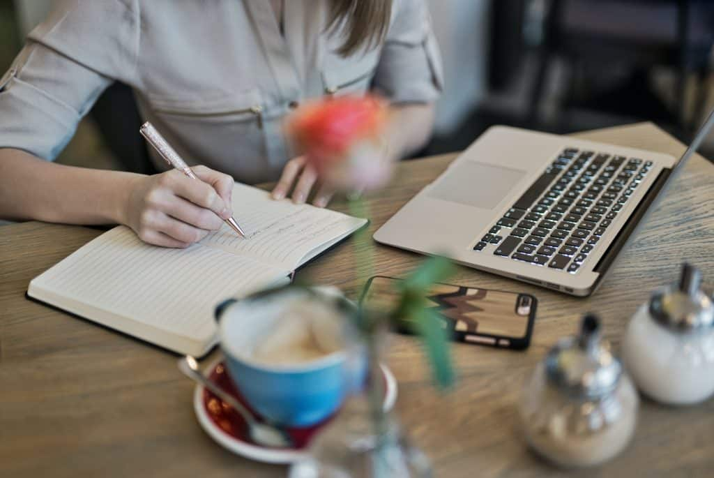 woman writing biography