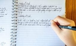 A young boy writes a diary of events during coronavirus lockdown as handwriting practice and to remember current events in the future. It is also a good home schooling activity.